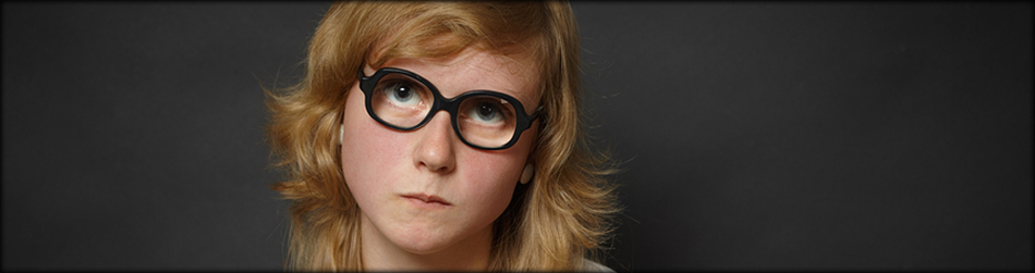 Well-read woman looks through spectacles